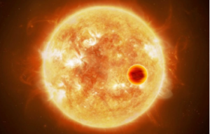Planeta cruzando el disco de sus estrella. Mediuante la técnica de los tránsitos planetarios se puede estudiar las propiedades de las atmósferas